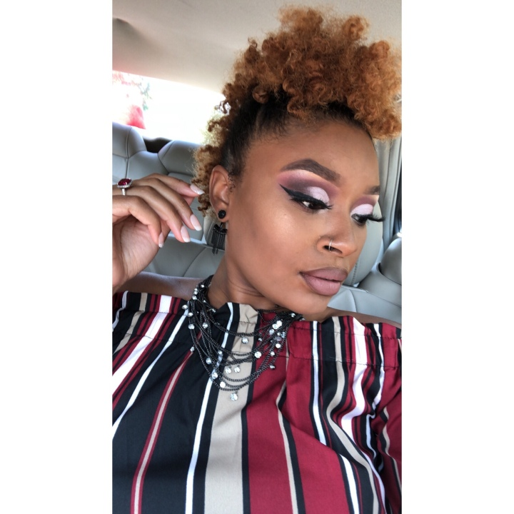 purple pink cut crease makeup on black woman
